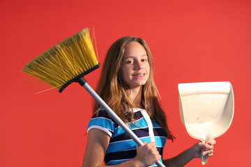 child working to clean house