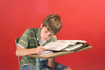 kid studying at desk