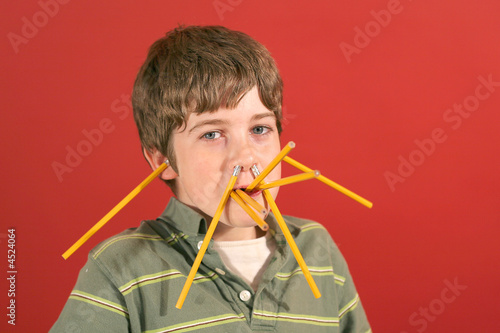 kid showing off being silly with pencils