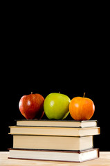 School books and Apples