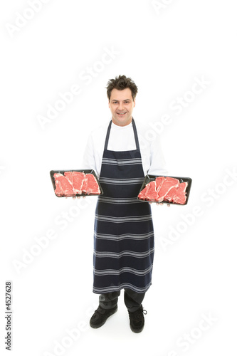 Butcher with trays of meat