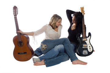 Two female guitarists taking a break