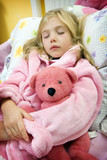 Child sleeping with teddy bear poster