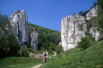 Cyclists, rocks