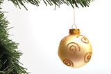 Gold glitter bauble on pine Christmas tree with white copy space poster