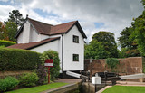 Idyllic rural canal side house for sale poster