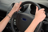 Woman showing correct hand position on steering wheel poster