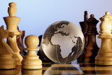 Globe and chess pieces