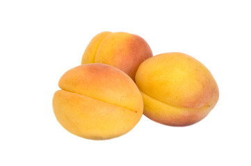 Three apricots on isolated white