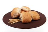 Granary bread rolls with wheat in the foreground poster
