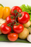 Cluster of tomatoes on vegetable background poster