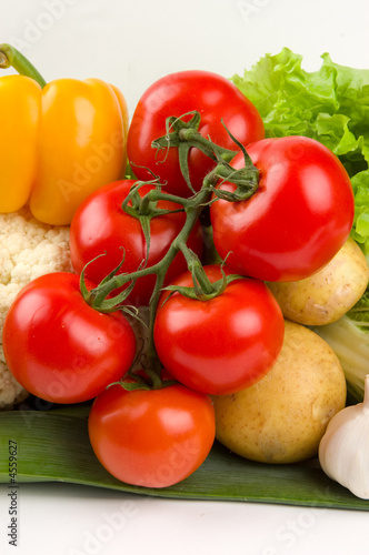 Cluster of tomatoes on vegetable background