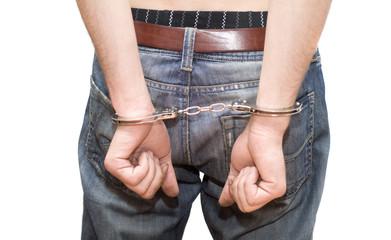 person in handcuffs.