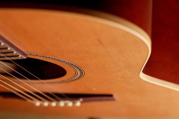 closeup details of an acoustic wooden guitar