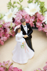 wedding flowers with groom and bride figures