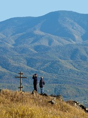 two hikers on the top