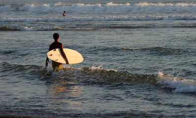 Surfer on the Kuta beach, Bali