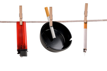 Cigarette,ashtray and lighter on clothesline