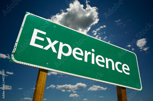 """Experience"" Road Sign with dramatic clouds and sky."