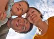 Happy family of three having fun outdoors
