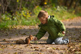 Little boy and squirrel