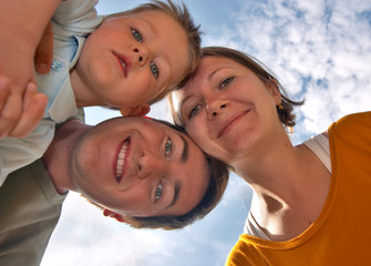 Happy family of three having fun outdoors