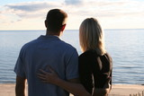 couple looking at lake love affection together poster
