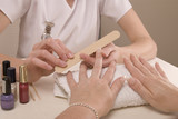 Manicurist filing clients finger nails poster