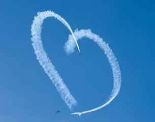 A heart in the sky, from skywriting biplanes