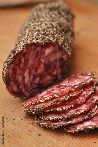 sliced salami on chopping board