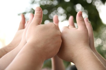 children hands with OK gesture
