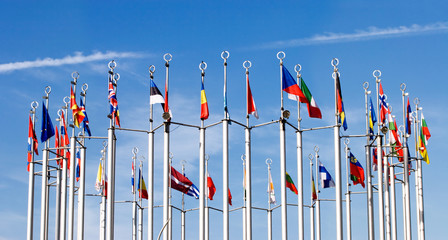 Flags on blue sky background