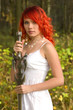 Pretty girl with vintage sword outdoor portrait