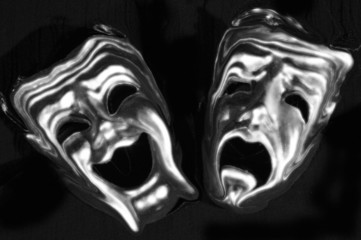 The masks of tragedy and comedy rendered as ghosts