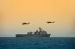 Leinwandbild Motiv Navy battleship with hovering helicopters