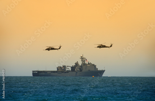 Leinwanddruck Bild Navy battleship with hovering helicopters