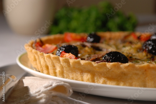 onion flan with olives and anchovies