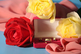 Roses and a box with gold jewelry on a blue background. poster
