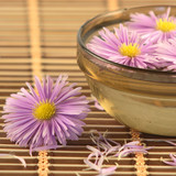 Bowl with flowers on a wooden napkin poster