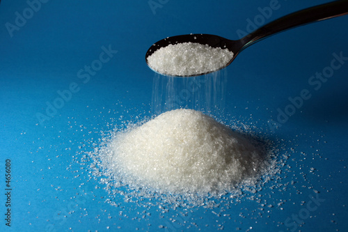 Heap of sugar and a spoon