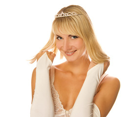 Beautiful blond girl with diamond diadem on her head isolated on