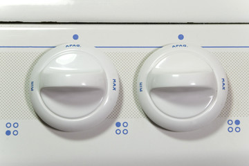 two stove buttons
