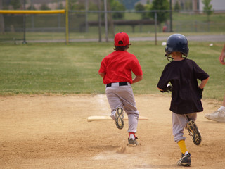 first baseman beating runner to first base
