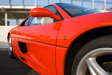 Side of bright red sports car