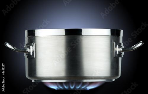 inox saucepan with gas flame