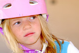 Thoughtful Child in a Safety Helmet poster