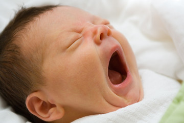 Newborn infant yawning