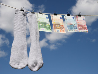 money laundering, euros drying up on the rope with socks