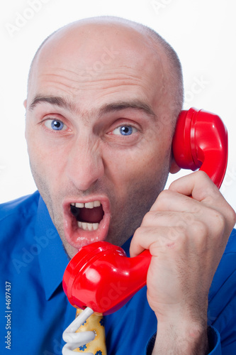 Businessman yelling into phone