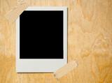 polaroid on plywood poster
